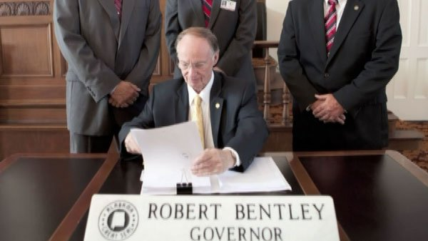Gov. Robert Bentley, R-AL, signs H.B. 56 into law. (Source: State of AL/CNN)