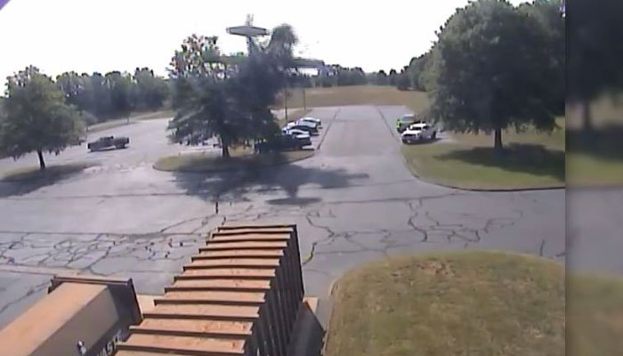 A plane clips a tree in Plainville, CT, on Monday before crashing into a parking lot. (Source: Plainville PD/CNN)