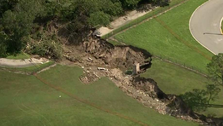 The jagged cavity opened up behind a middle school in Apopka, devouring a chunk of the West Orange trail. (Source: WESH/CNN)