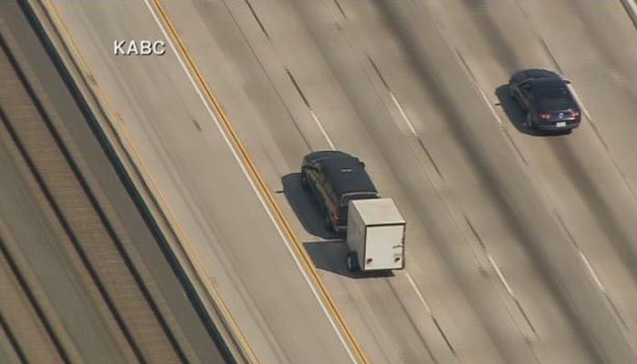 Police are chasing a stolen SUV towing a trailer. (Source: KABC/CNN)
