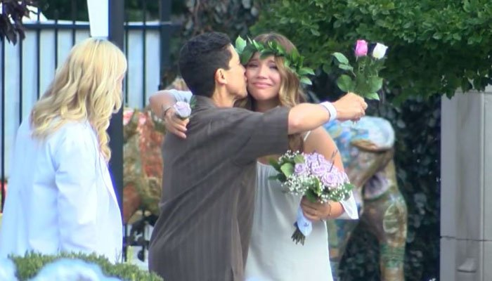 After her father's cancer diagnosis, a bride moved her wedding across the country, so he could still give her away. (Source: WKBW/CNN)