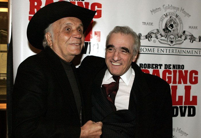 "Boxer and author Jake LaMotta, left, fakes a punch to ""Raging Bull"" filmmaker Martin Scorsese's gut for photographters before watching a 25th anniversary screening of the movie Thursday, Jan. 27, 2005 in New York. (AP Photo/Julie Jacobson)"