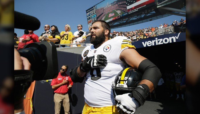 Pittsburgh Steelers offensive tackle and former Army Ranger Alejandro Villanueva (78) stands outside the tunnel alone during the national anthem before an NFL football game against the Chicago Bears on Sunday. (AP Photo/Nam Y. Huh)
