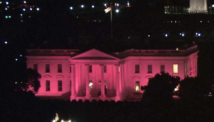 For the 10th consecutive year, the White House was lit in pink Sunday night to commemorate Breast Cancer Awareness Month. (Source: CNN/Pool)