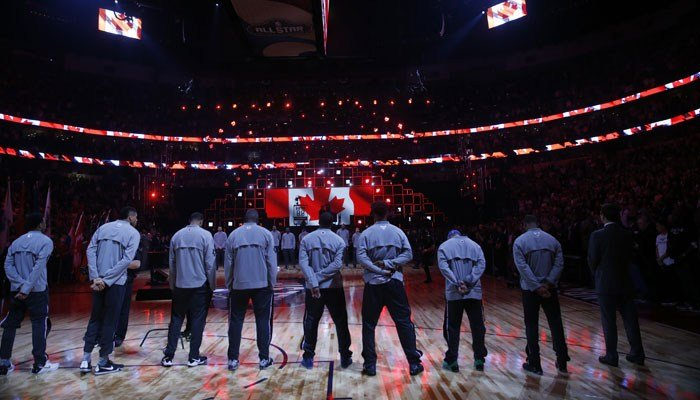 Players listen to the Canadian anthem play before the NBA All-Star basketball game in New Orleans, Sunday, Feb. 19, 2017. (AP Photo/Gerald Herbert)