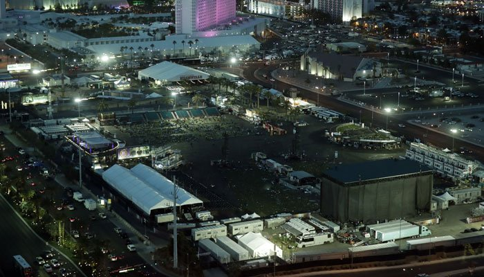 The festival grounds across the street from the Mandalay Bay resort and casino, where a mass shooting occurred, is seen at nighttime Tuesday, Oct. 3, 2017, in Las Vegas. (Source: AP Photo/Marcio Jose Sanchez)
