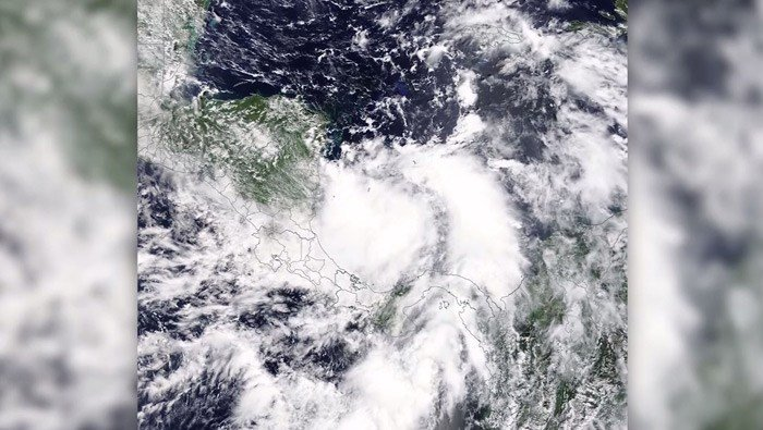 NASA spotted Tropical Depression 16 in the southwestern Caribbean on Wednesday, which would become Tropical Storm Nate less than 24 hours later. (Source: NASA/CNN)