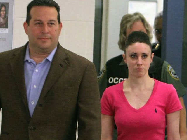 Anthony's attorney Jose Baez (left) accompanied her as she was taken to an undisclosed location. (Source: CNN)