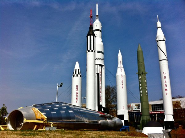 The Mercury-Atlas (front), laid on its side, is joined by various other rockets, including the Mercury-Redstone (with the red eject tower) and the Saturn IB (furthest back). (Source: J. Sebe Dale IV)