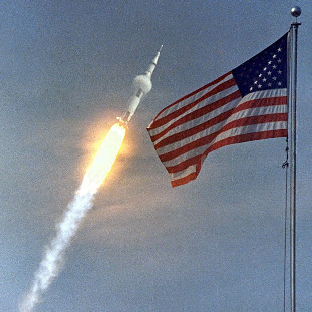 The American flag heralds the flight of Apollo 11, the first Lunar landing mission. The Apollo 11's Saturn V lifted off with astronauts Neil Armstrong, Michael Collins and Buzz. Aldrin on July 16, 1969 from the Kennedy Space Center. (Source: NASA)