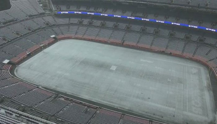 A coat of snow covers the Denver Broncos football field on Monday. (Source: KDVR/CNN)