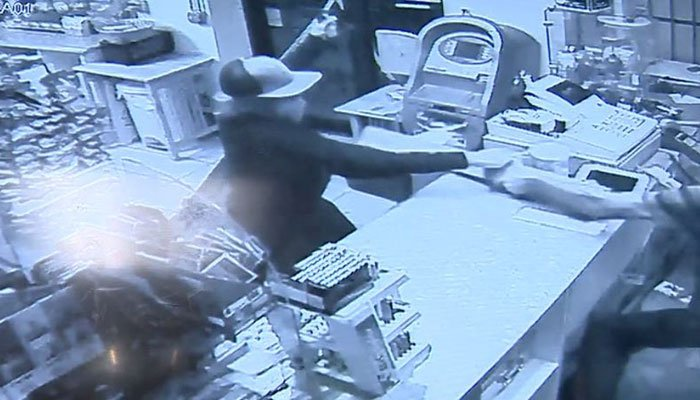 Store video shows the store clerk fighting back, and taking aim at the self-declared ninja with a 2-by-4. (Source: WCVB/store video/CNN)