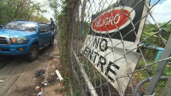 Nearly a month after Hurricane Maria hit Puerto Rico, residents around the town of Dorado keep tapping into a water faucet behind a chain link fence with a sign that reads 'Danger, do not enter.' (Source: CNN)
