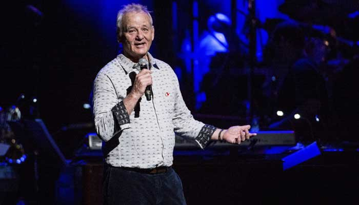 Actor Bill Murray, seen here at Love Rocks NYC March 9, collected $20 bills for autographs Monday to raise funds for hurricane relief in Puerto Rico. (Source: Amy Harris/Invision/AP))