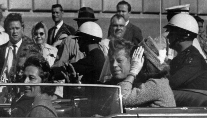 President John F. Kennedy rides in a motorcade with his wife Jacqueline moments before he was shot and killed in Dallas on Nov. 22, 1963. Texas Governor and Mrs. John Connally are also in the car. (Source: AP Photo)
