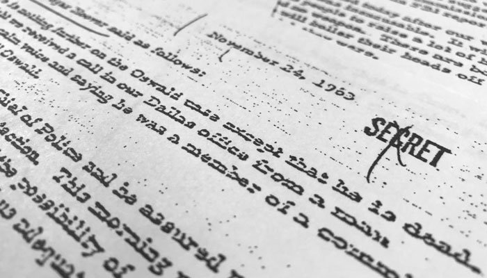 Part of a file, dated Nov. 24, 1963, quoting FBI director J. Edgar Hoover as he talks about the death of Lee Harvey Oswald, released for the first time on Thursday, Oct. 26, 2017, is photographed in Washington.  (Source: AP Photo/Jon Elswick)