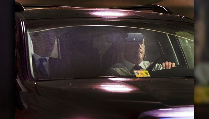 Former Trump Campaign Chairman Paul Manafort, left, leaves his home in Alexandria, Va., Monday, Oct. 30, 2017, in Washington. (AP Photo/Andrew Harnik)