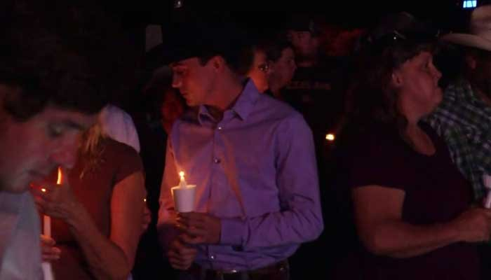 Mourners gathered for a vigil across the street from the church that was the site of a mass shooting that left 26 dead in Sutherland, TX. (Source: CNN)