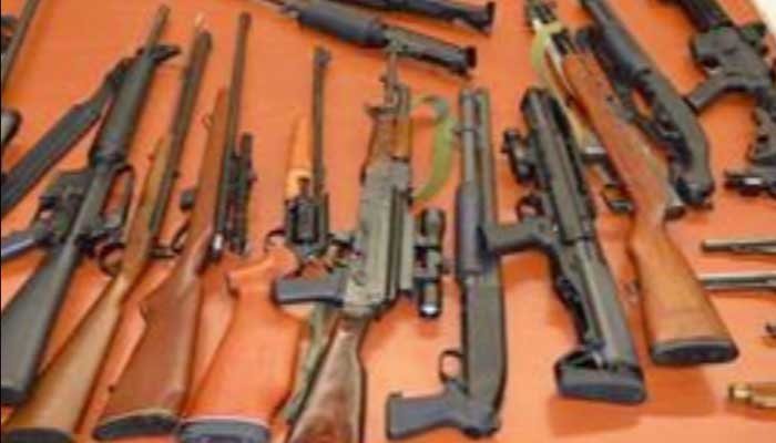 After finding a cache of weapons including assault rifles and explosives at a man's home, police tracked him down at a hotel, where he had an AR-15, and arrested him. (Source: WTEN/CNN/Albany Co. Sheriff)