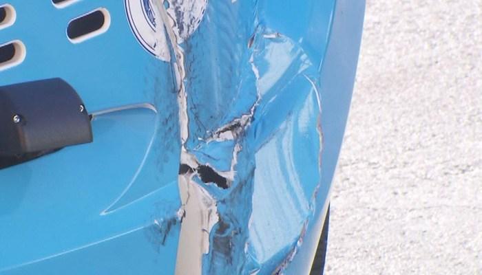 The autonomous shuttle bus was dented in the crash. No humans were hurt. (Source: KLAS/CNN)
