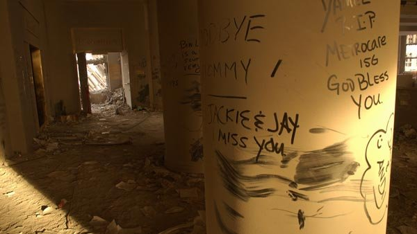 Messages written in the dust on the walls of buildings adjacent to the World Trade Center. (Source: Andrea Booher/FEMA News Photo)