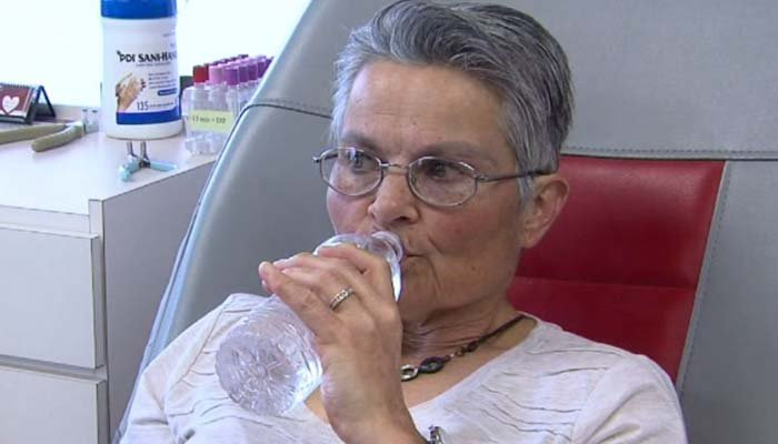 Marty Robinson relaxes as another pint of blood - her 240th - is drawn. (Source: KTWO via CNN)