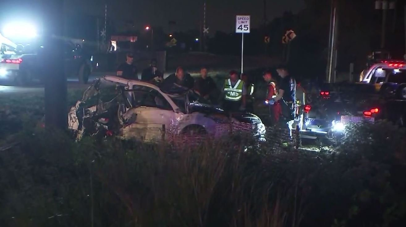 Police say an SUV was going more than 100 mph when it slammed into the back of a minivan waiting at a red light. (Source: KTRK/CNN)