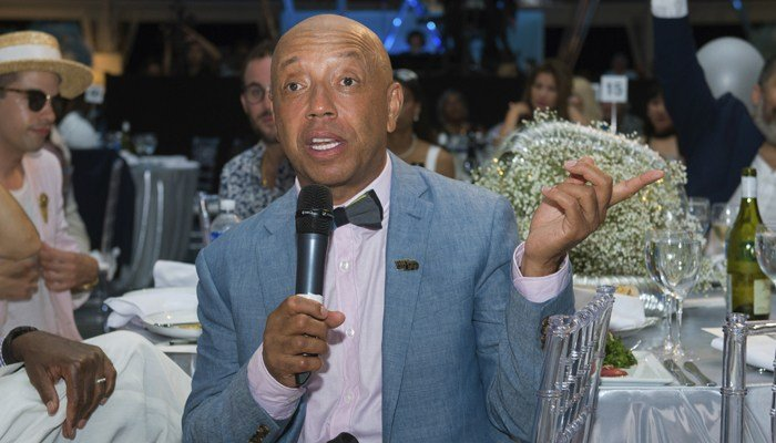 Russell Simmons, pictured in this 2017 photo at the Art For Life benefit in New York, has stepped down from his businesses after accusations of sexual assault. (Source: Scott Roth/Innvision/AP)