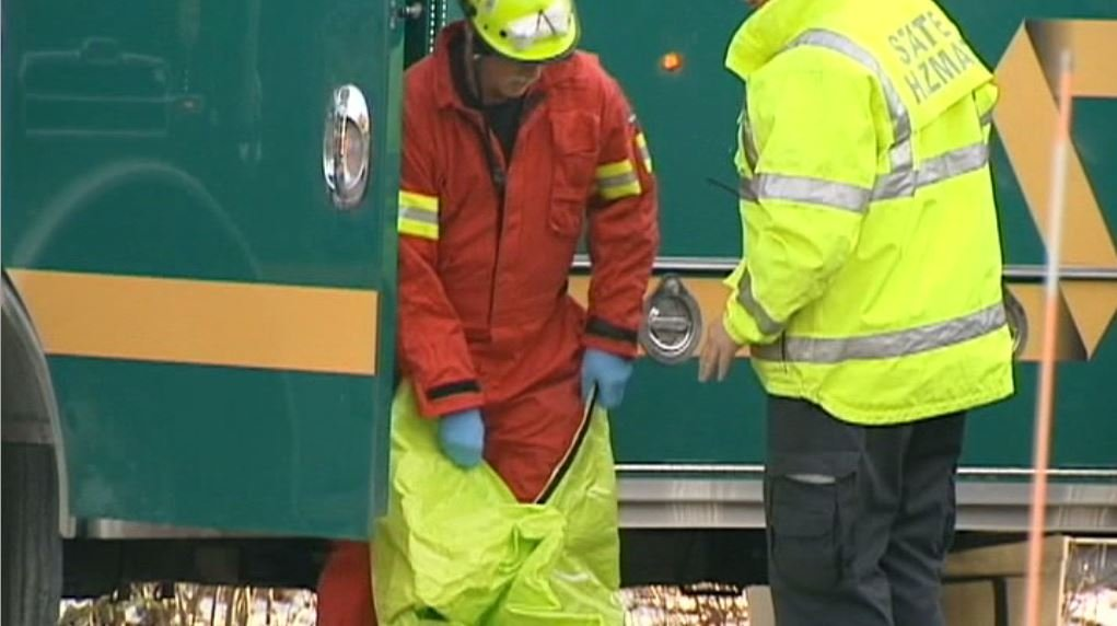 Investigators don hazmat suits to check the retirement community apartment for ricin. (Source: WPTZ/CNN)