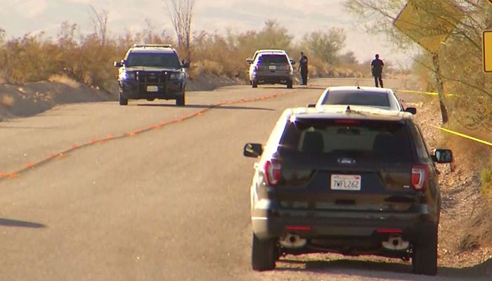 Police converge on the area where a veteran's body was found. (Source: KMIR/CNN)