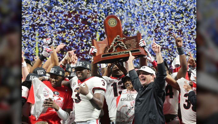 Georgia head coach Kirby Smart and team hold the SEC championship trophy after the Southeastern Conference championship NCAA college football game against Auburn, Saturday, Dec. 2, 2017, in Atlanta. Georgia won 28-7. (AP Photo/John Bazemore)