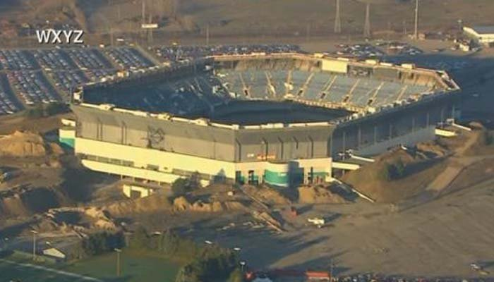 The Pontiac Silverdome following an implosion attempt. The roof had already been removed. (Source: WXYZ via CNN)