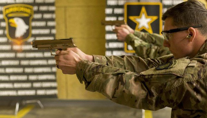 A soldier in the 101st Airborne Division of the U.S. Army test fires the new Sig Sauer M17. (Source: U.S. Army/101st Airborne)
