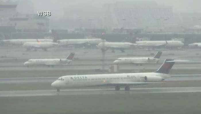 Dozens of planes were stranded on the runway at the airport in Atlanta. (Source: WSB/CNN)