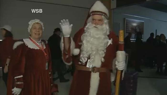 A man dressed as Santa Claus said he had 'all the elves' working to restore the power. (Source: WSB via CNN)