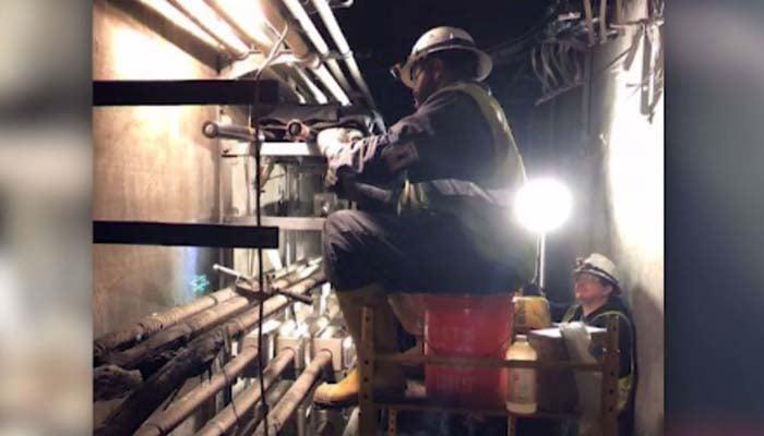 A crew with Georgia Power works to repair the damage. (Source: Georgia Power via CNN)