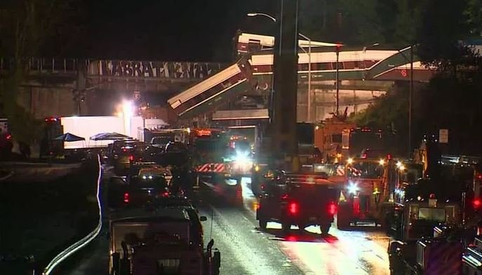 Recovery efforts stretched into the night Monday after an Amtrak passenger train derailed onto a highway in Dupont, WA. (Source: KIRO/CNN)