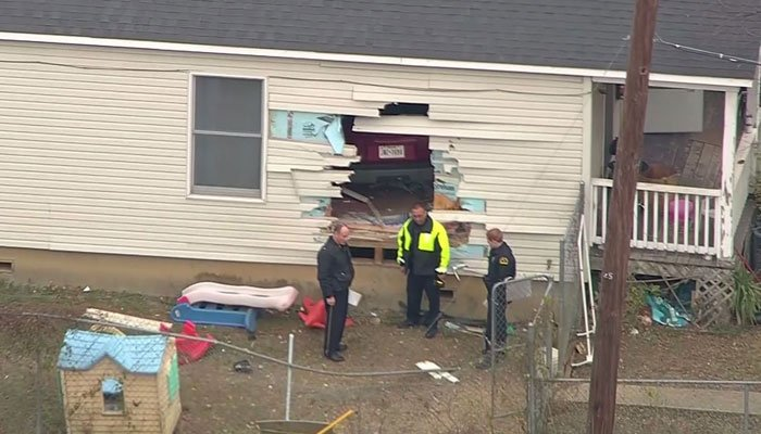 Police said the vehicle appeared to be speeding, but eventually came to rest in the living room.  (Source: KTVT/CNN)