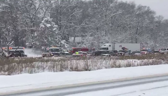 It all reportedly started when a car spun out of control in near zero visibility. (Source: WOOD/CNN)