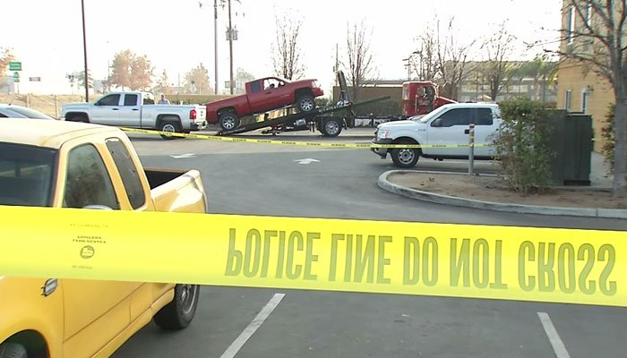 Police gather evidence at the scene where the woman took her life on Friday. (Source: KBAK/CNN)