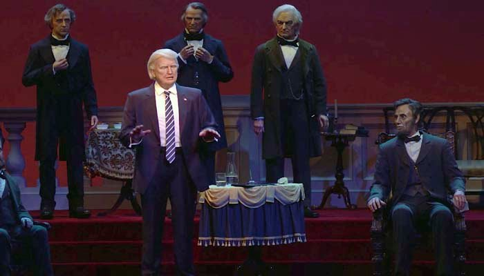 This undated video screen shot provided by Walt Disney World shows an animatronic figure of Donald Trump, center front, at the Hall of Presidents attraction at Walt Disney World in Orlando, Fla. (Walt Disney World via AP)