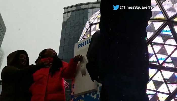 Tarana Burke, left, practiced Saturday pulling the switch for the annual ball drop over Times Square for New Year's Eve. Burke is the founder of the #MeToo movement. (Source: Twitter @TimesSquareNYC/CNN)