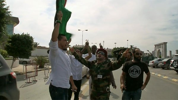 Celebrations broke out in the streets of Libya's capital as people learned of Gadhafi's death. (Source: CNN)