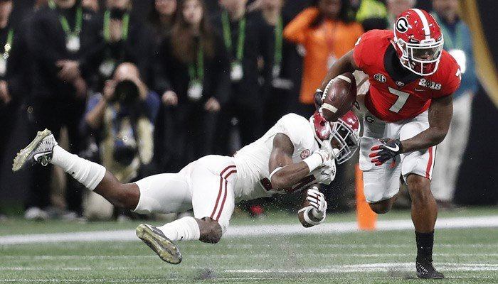 Georgia running back D'Andre Swift gets past Alabama's Deionte Thompson. Georgia kept Alabama off the score board in the first half. (AP Photo/David Goldman)