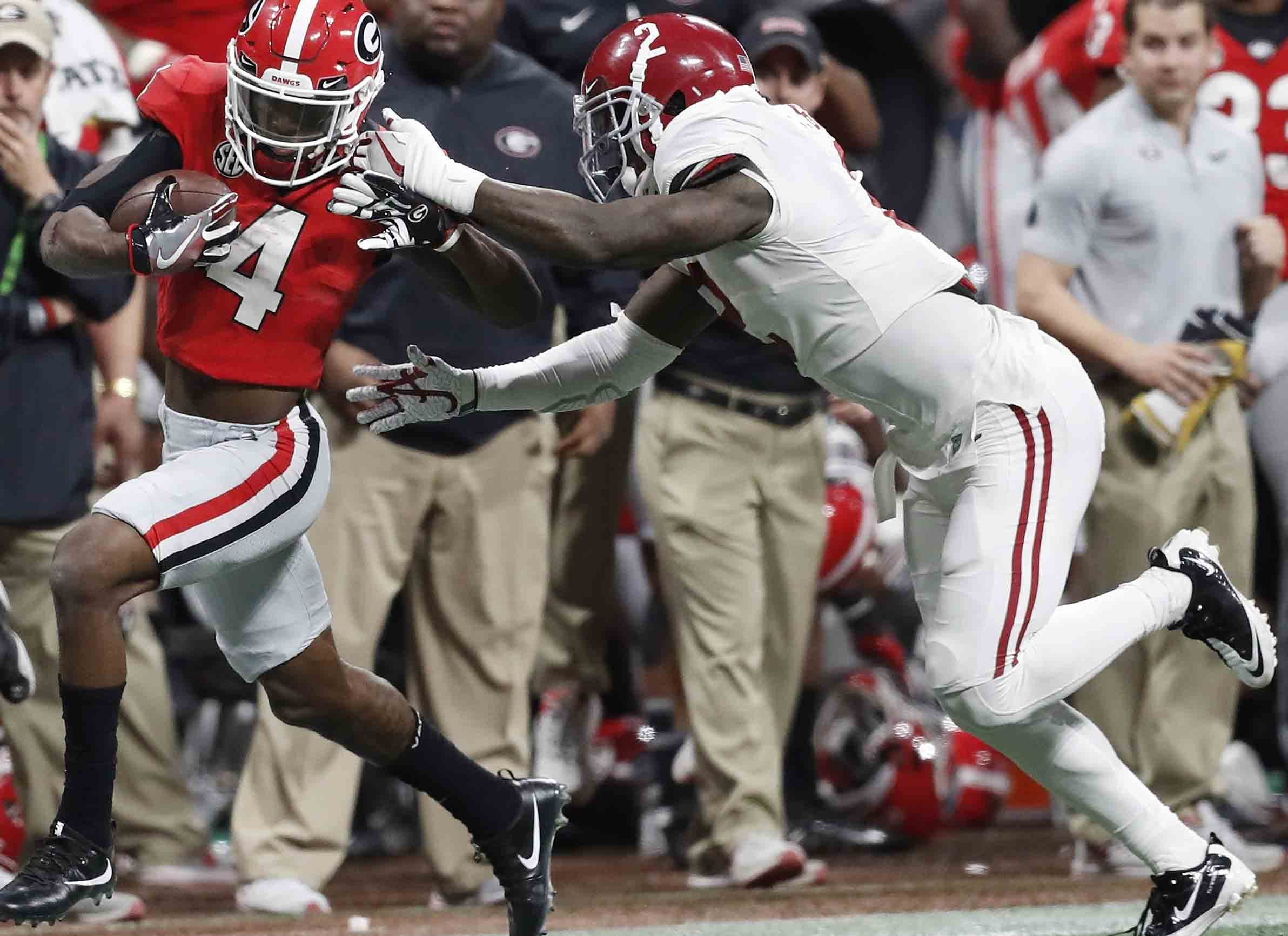 Georgia wide receiver Mecole Hardman gets past Alabama defensive back Tony Brown for a touchdown catch during the third quarter. (AP Photo/David Goldman)