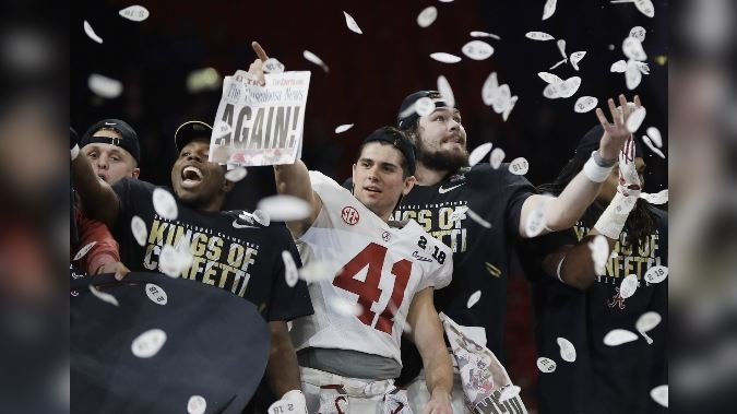Alabama players celebrate after overtime of the NCAA college football playoff championship game against Georgia. (AP Photo/David J. Phillip)
