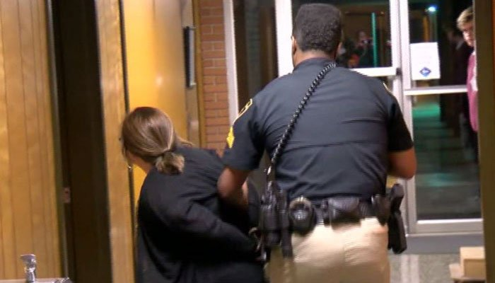 The teacher asked school board members why the superintendent received a raise. She was arrested shortly after.(Source: KATC/CNN)