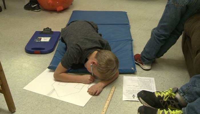This is the first year L'anse second-graders are doing away with desks in their classrooms. (Source: WLUC/CNN)