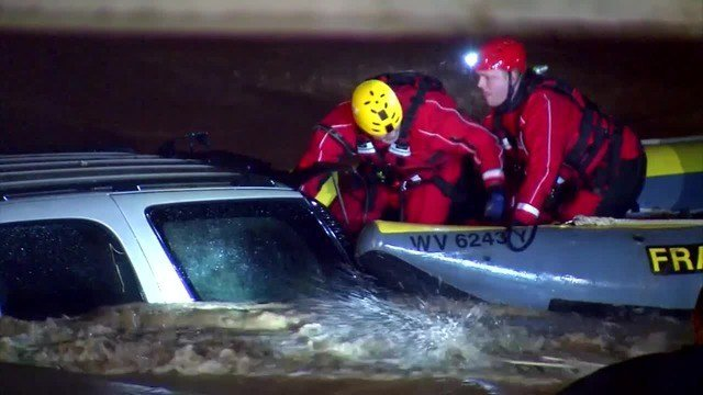 A driver trapped inside his SUV Friday night, as water rushed around it, left first responders with just minutes to take action. (Source: WCHS/WVAH/CNN)