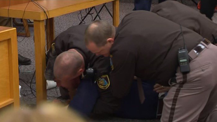 An angry father rushed at Larry Nassar at the beginning of court Friday and had to be tackled by deputies.  Nassar was in court for his third and final sentencing hearing. (Source: Pool/CNN))